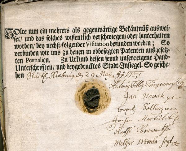 Fragment księgi obciążeń mieszczan rybnickich zodciskiem pieczęci miejskiej